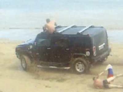 http://de.acidcow.com/pics/20120824/video/hummer_on_beach.jpg